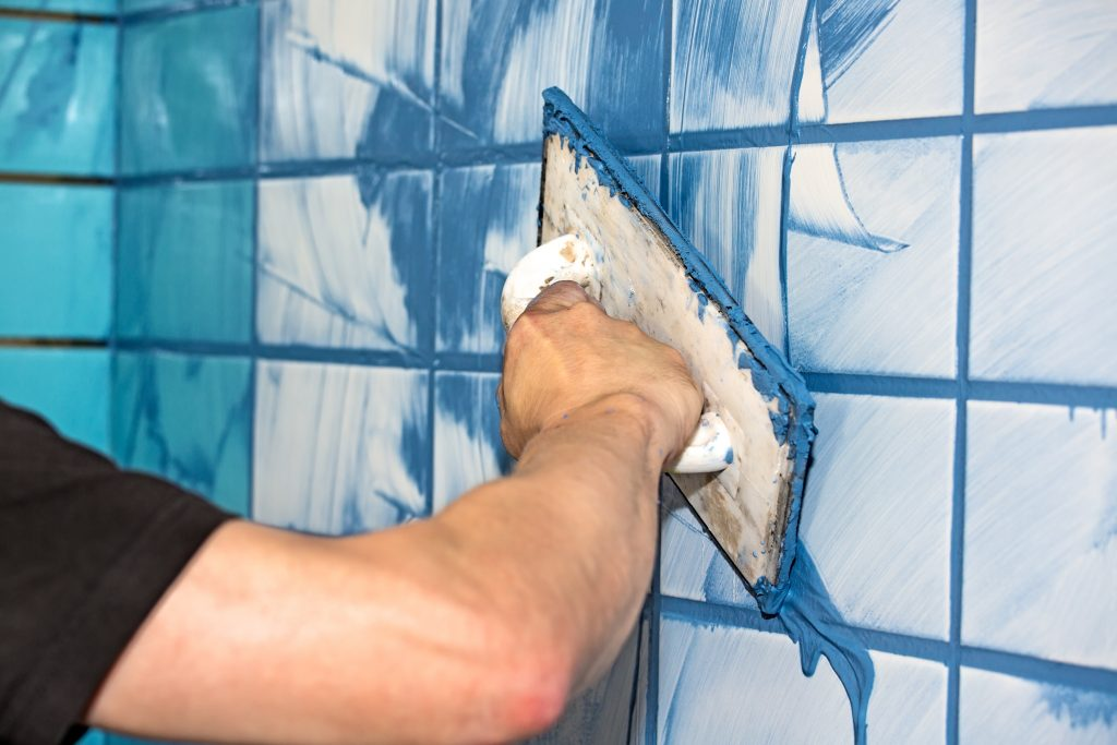 Blue grout to white interior tiles
