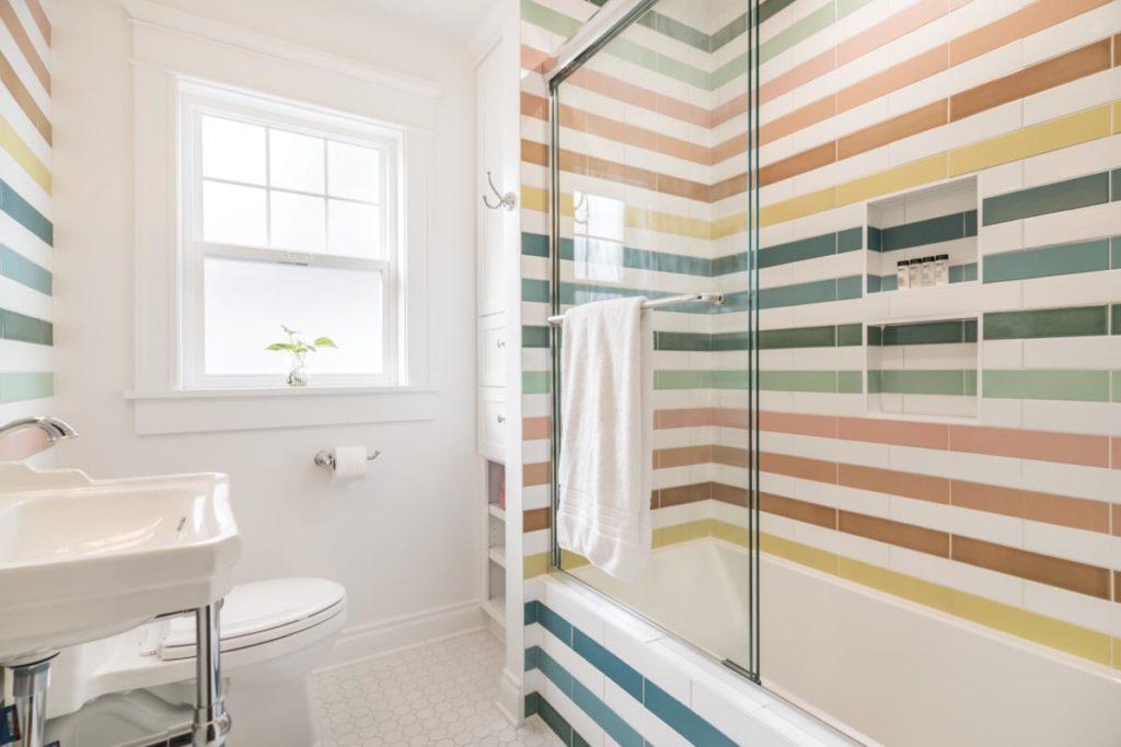 Bathroom with multicoloured tiles creating a rainbow effect
